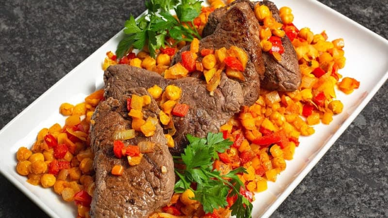 Top Sirloin Steaks with Cumin, Peppers, and Chickpeas